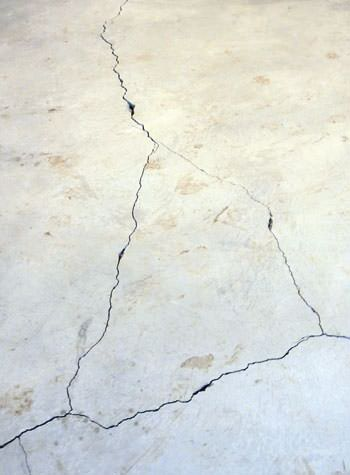 severely cracked, heaving slab floors in a home in Massena