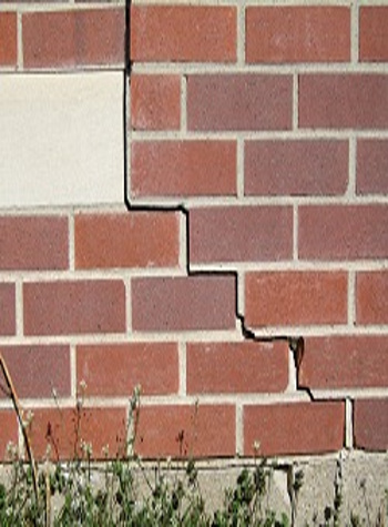photo of a rotating foundation wall with cracks in Camillus